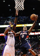 Mar. 1, 2013; Phoenix, AZ, USA; Atlanta Hawks guard Jeff Teague (0) lays up the ball against the Phoenix Suns center Jermaine O'Neal (20) in the first half at US Airways Center. The Suns defeated the Hawks 92-87. Mandatory Credit: Jennifer Stewart-USA TODAY Sports