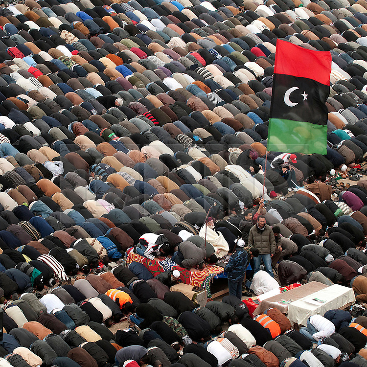 © under license to London News Pictures. 25/02/2011. People pray at midday Friday prayers at the main square in Benghazi, Libya. Photo credit should read Michael Graae/London News Pictures