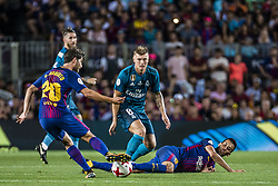 August 13, 2017 - Barcelona, Catalonia, Spain - FC Barcelona midfielder S. ROBERTO competes with Real Madrid midfielder KROOS for the ball during the Spanish Super Cup Final 1st leg between FC Barcelona and Real Madrid at the Camp Nou stadium in Barcelona (Credit Image: © Matthias Oesterle via ZUMA Wire)