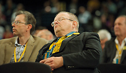 A member of the Lib Dems appears to be asleep  at The Liberal Democrats Annual Conference in Brighton, Sunday September 23, 2012. Photograph by Elliott Franks / i-Images