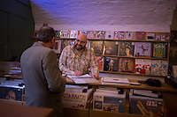 Glasgow, Scotland - JULY 11, 2014: Russell Elder chats with a customer at Monorail Music, an independent record shop revered for it's vast vinyl collection, which ranges from classics to wild rarities. Founded by a local musician, Monorail is a vital part of the Glasgow music scene and has hosted in-store gigs for the likes of local legends such as Belle and Sebastian. CREDIT: Chris Carmichael for The New York Times