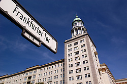 Detail of street sign and historic building at Frankfurter Tor off karl Marx Allee in Berlin Germany