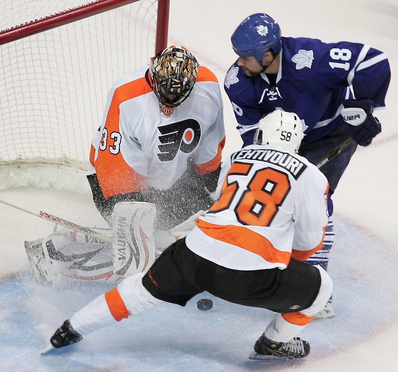 Philadelphia's Joonas Lehtivouri and Mike Brown of the Toronto Maple Leafs crash the net of Flyers goalie Brian Boucher during the second period of an NHL exhibition game at the John Labatt Centre in London, Ontario, September 23, 2010.<br /> REUTERS/Geoff Robins (CANADA)