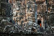 Novice buddhist monks make pilgrimage to the Bayon, Angkor Thom.