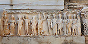 Frieze depicting Emperor Theodosius with Olympian gods, Temple of Hadrian, 2nd century AD, Curetes Street, Ephesus, Izmir, Turkey. The temple was built by Quintilius before 138 AD and was dedicated to the Emperor Hadrian, who came to visit the city from Athens in 128 AD. Inside the temple are friezes depicting the story of the foundation of Ephesus - Androkles shooting a boar, Dionysus in ceremonial procession and the Amazons. The fourth frieze, shown here, depicts Emperor Theodosius, his wife and son (Arcadius), and various Olympian gods including Athena, Apollo, Androcles, Herakles and Artemis. Ephesus was an ancient Greek city founded in the 10th century BC, and later a major Roman city, on the Ionian coast near present day Selcuk. Picture by Manuel Cohen
