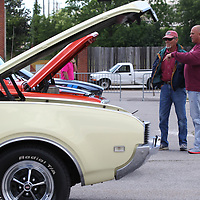 Don Grace, left, of Smith Lake Alabama and Phillip Hall of Nettleton talk about Grace's truck he brought to this year's Blue Suede Cruise on Friday.