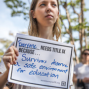 WASHINGTON,DC-JUL13:  Katherine Davis, who volunteered with the University of Michigan sexual assault prevention and awareness center, before graduating in 2017, attends a rally for survivors of sexual assault and their allies, outside the Department of Education, ahead of a series of meetings that Secretary Betsy DeVos is holding with survivors, advocates for the wrongly accused and college administrators. DeVos is considering whether to rollback Obama-era guidance on handling sexual assault, which victims' advocates credit with improving the situation on college campuses, and which others say has led schools to err on the side of finding students guilty of assault even when they are innocent. (Photo by Evelyn Hockstein/For The Washington Post)
