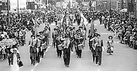 Twelfth, Belfast, 1977, Orangemen & bands make their way through Dublin Road, on their way to The Field at Edenderry. 197707120150<br />