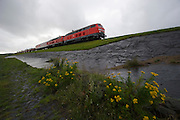 The Sylt Shuttle train transporting cars across the Hindenburgdamm links the island of Sylt with the mainland.