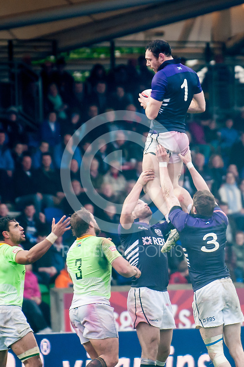 Scott Riddell takes a line out for Scotland against South Africa. Action from the IRB Emirates Airline Glasgow 7s at Scotstoun in Glasgow. 4 May 2014. (c) Paul J Roberts / Sportpix.org.uk