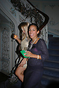 Katie Sawdon and Zaffron Bennett, Tiffany & Co. Christmas party. the Savile Club. Brook St. London. 14 December 2004.  ONE TIME USE ONLY - DO NOT ARCHIVE  © Copyright Photograph by Dafydd Jones 66 Stockwell Park Rd. London SW9 0DA Tel 020 7733 0108 www.dafjones.com