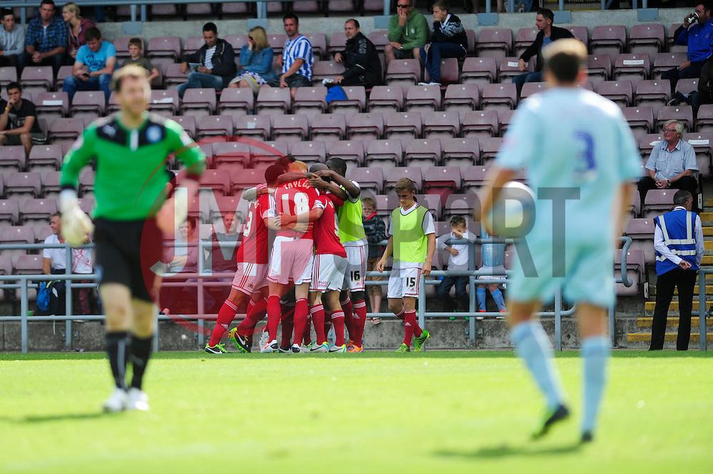Bristol City's Sam Baldock celebrates with his team mates after scoring to make it 3-3.  - Photo mandatory by-line: Dougie Allward/JMP - Tel: Mobile: 07966 386802 11/08/2013 - SPORT - FOOTBALL - Sixfields Stadium - Sixfields Stadium -  Coventry V Bristol City - Sky Bet League One