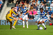 Queens Park Rangers midfielder Eberechi Eze (10) and Wigan Athletic midfielder Nick Powell (25) during the EFL Sky Bet Championship match between Queens Park Rangers and Wigan Athletic at the Loftus Road Stadium, London, England on 25 August 2018.