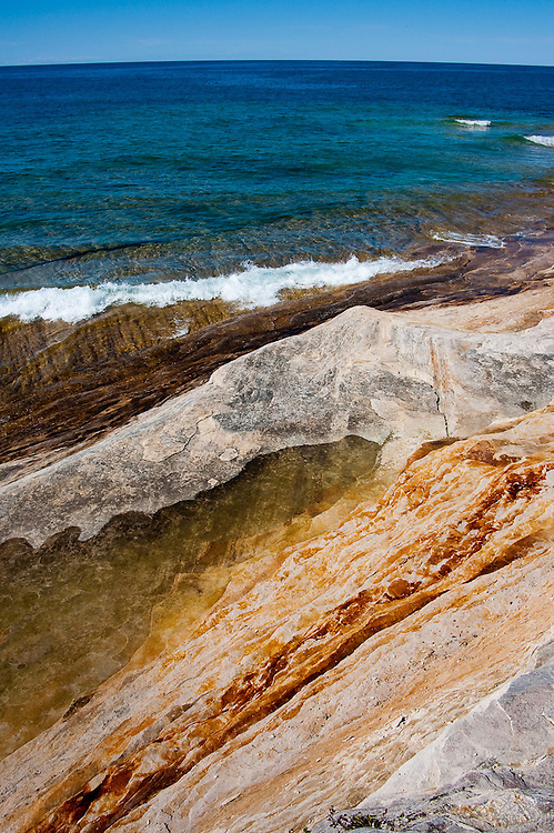 Colorful layers of rock on the shore of Mosquito Point, Pictured Rocks National Lakeshore, Michigan
