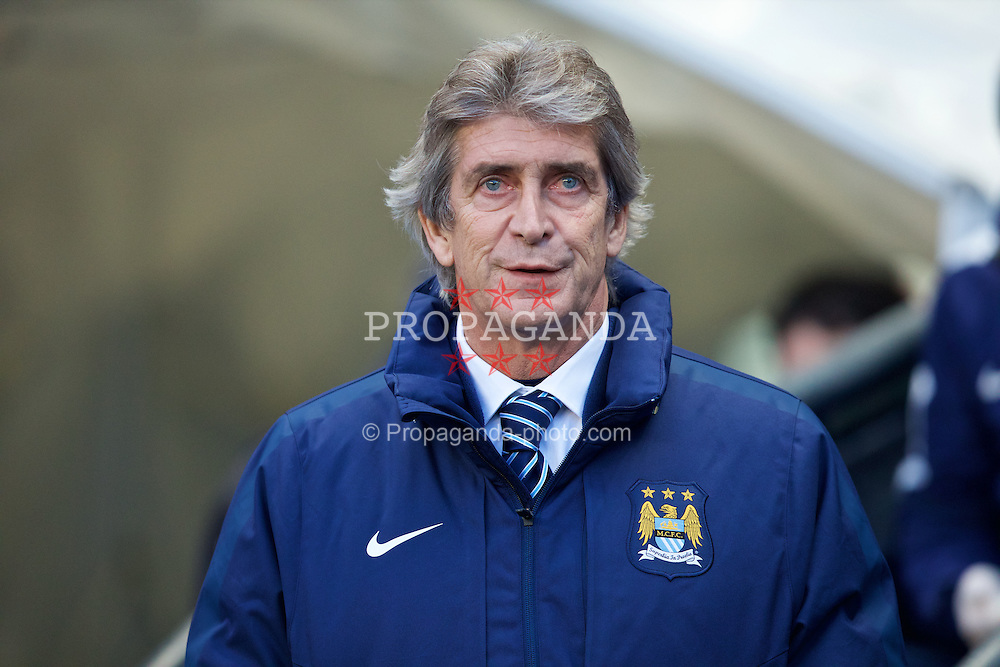 MANCHESTER, ENGLAND - Sunday, January 18, 2015: Manchester City's manager Manuel Pellegrini before the Premier League match against Arsenal City at the City of Manchester Stadium. (Pic by David Rawcliffe/Propaganda)