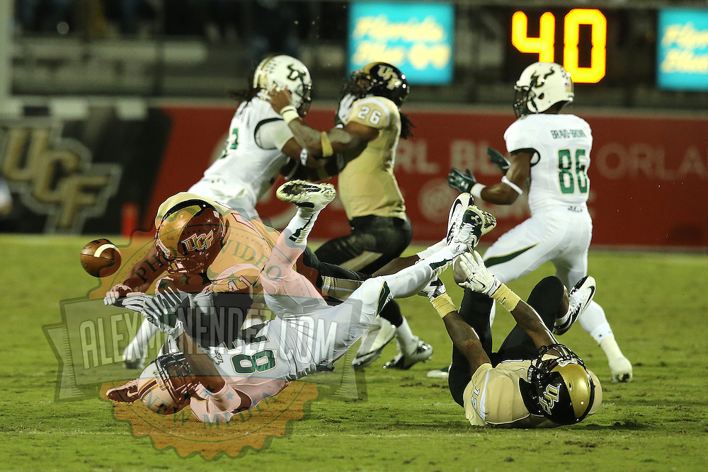 South Florida Bulls wide receiver Derrick Hopkins (87) gets hit by UCF Knights linebacker Terrance Plummer (41) during an NCAA football game between the South Florida Bulls and the 17th ranked University of Central Florida Knights at Bright House Networks Stadium on Friday, November 29, 2013 in Orlando, Florida. This Knights won the game 23-20. (AP Photo/Alex Menendez)