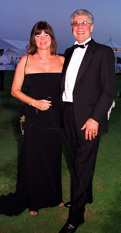 MR & MRS RICHARD BIFFA the waste disposal multi millionaires, at a party in Oxfordshire on 11th September 1999.MWE 9