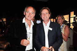 Left to right, brothers LUDOVIC LINDSAY and JAMES LINDSAY at an auction and priavte view of paintings, drawings, stories and doodles by well known personalities held at Christie's, St.James's, London on 20th September 2010.