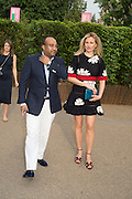 RON WAHID; MAGDALENA WAHID, 2016 SERPENTINE SUMMER FUNDRAISER PARTY CO-HOSTED BY TOMMY HILFIGER. Serpentine Pavilion, Designed by Bjarke Ingels (BIG), Kensington Gardens. London. 6 July 2016