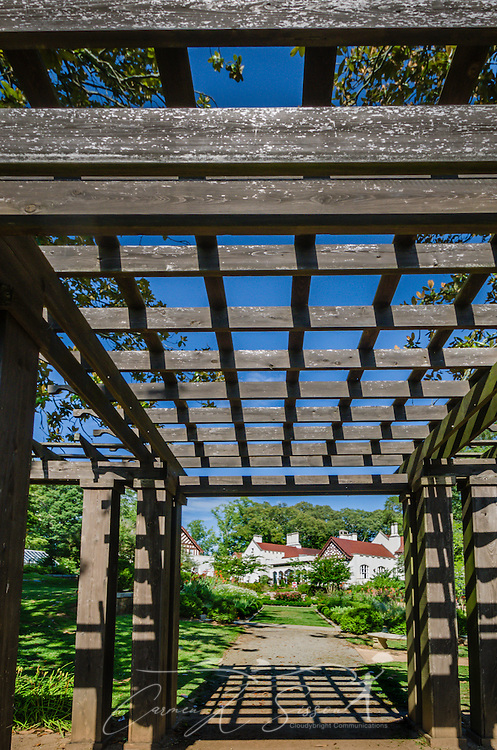 A garden pathway leads to Callanwolde Fine Arts Center, which is housed within a 27,000 square foot Gothic-Tudor Revival mansion and nestled on 12 acres in Atlanta, Georgia. The house, built in 1920, was the home of Charles Howard Candler, son of the founder of the Coca-Cola Company. The house was designed by architect Henry Hornbostel. Today, Callanwolde operates as a non-profit organization devoted to teaching and promoting the visual, literary and performing arts. (Photo by Carmen K. Sisson/Cloudybright)