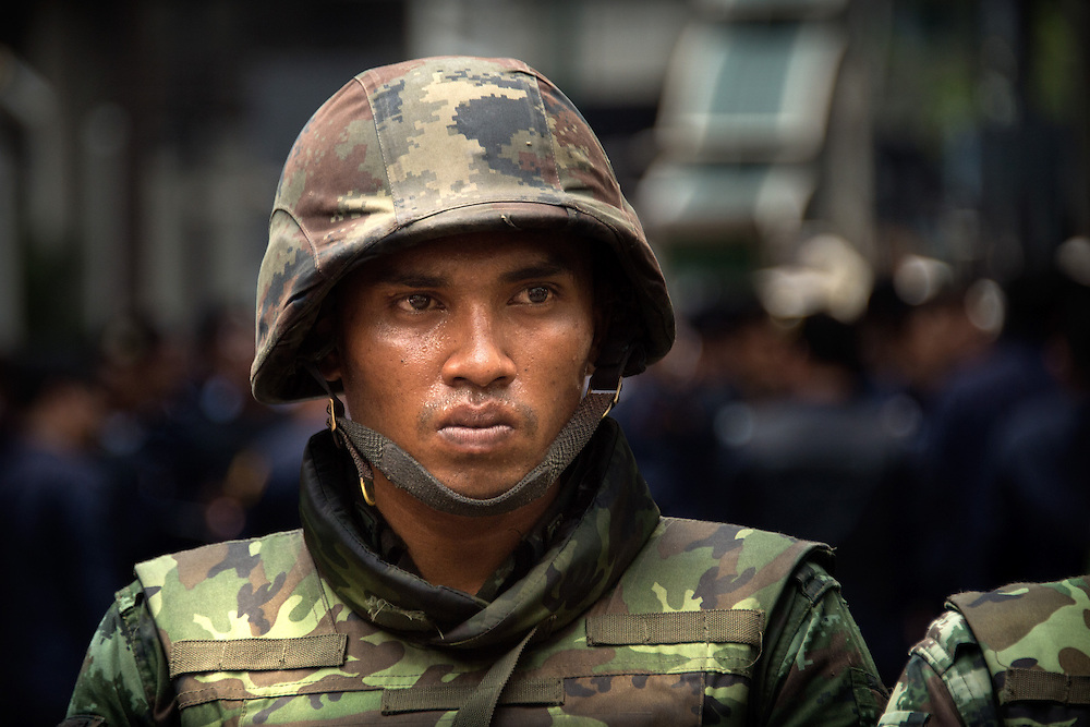 An intense soldier holds the line during an anti-coup protest in central Bangkok, Thailand, May 25, 2014.