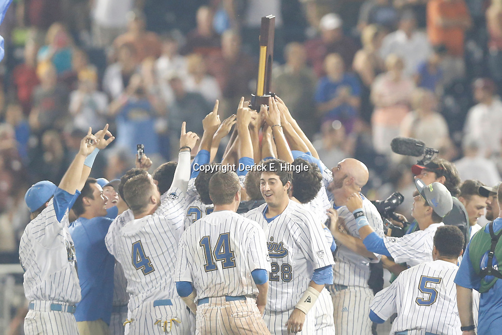 Jun 25, 2013; Omaha, NE, USA; UCLA Bruins hoist the championship trophy after game 2 of the College World Series finals against the Mississippi State Bulldogs at TD Ameritrade Park. UCLA defeated Mississippi State 8-0. Mandatory Credit: Derick E. Hingle-USA TODAY Sports