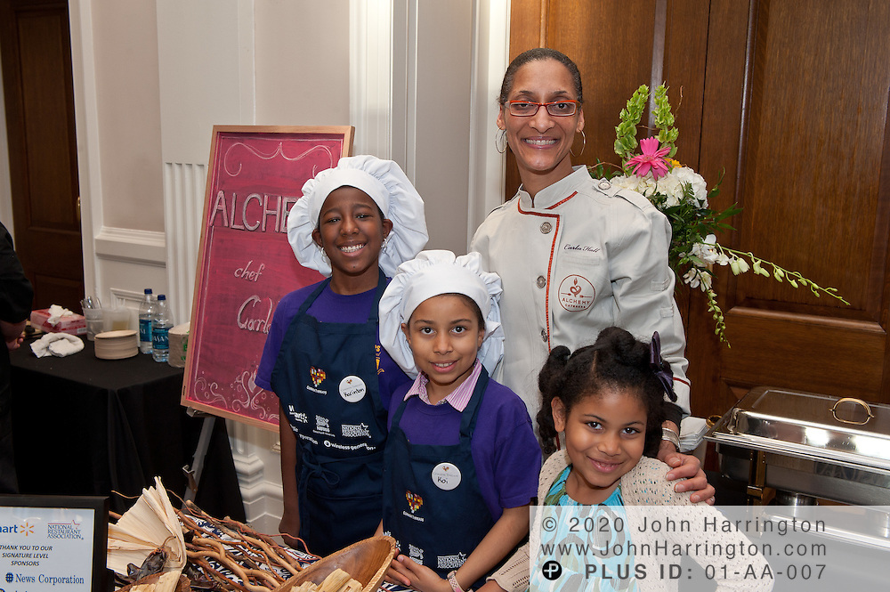 Chef Carla Hall of Alchemy and Bravo's Top Chef All Stars greets DC schoolchildren who participated at the Common Threads World Festival at the Carnegie Institution in Washington, DC on April 6th, 2011, brought together influential area chefs, politicians, and food enthusiasts for a fundraiser for after-school programs in Washington.