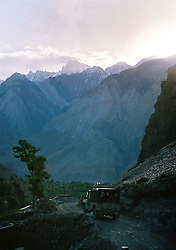Pakistan, Northwest Frontier Province, 2004. Along the rough road outside Chitral, the rugged beginnings of the Hindu Kush can be seen in the early morning.