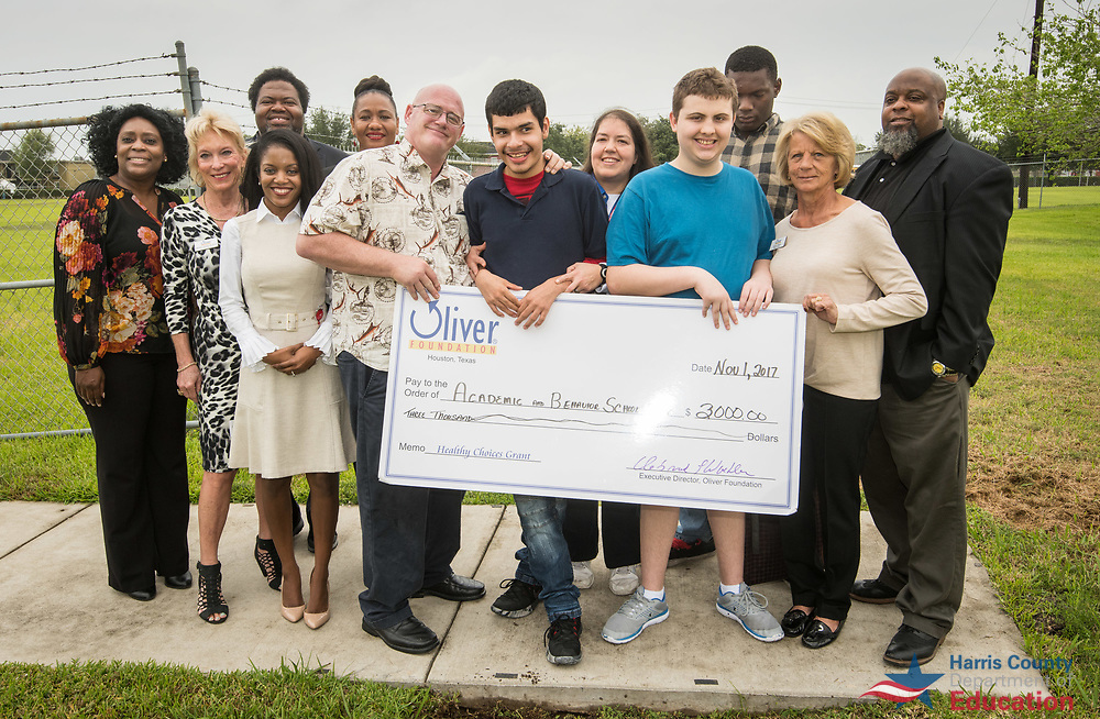 Oliver Foundation representatives present a $3000 grant to help fund a garden at the Academic and Behavioral School East, November 1, 2017.