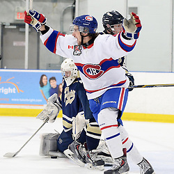 TORONTO, ON - Mar 31 : Ontario Junior Hockey League, Toronto Patriots v Toronto Jr. Canadiens, SouthWest Championship Series, Game 3. Andrew Pucci #4 of the Toronto Jr. Canadiens Hockey Club celebrates the goal celebrates the goal during the second period.<br /> (photo by Jay Johnston / OJHL Images)