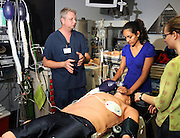 Clinical educator, John Jarred, (left), instructs pre-med students, Marisa Cornejo and Katherine Bakke, at the Arizona Simulation Technology and Education Center, University Medical Center, University of Arizona, Tucson, Arizona, USA.