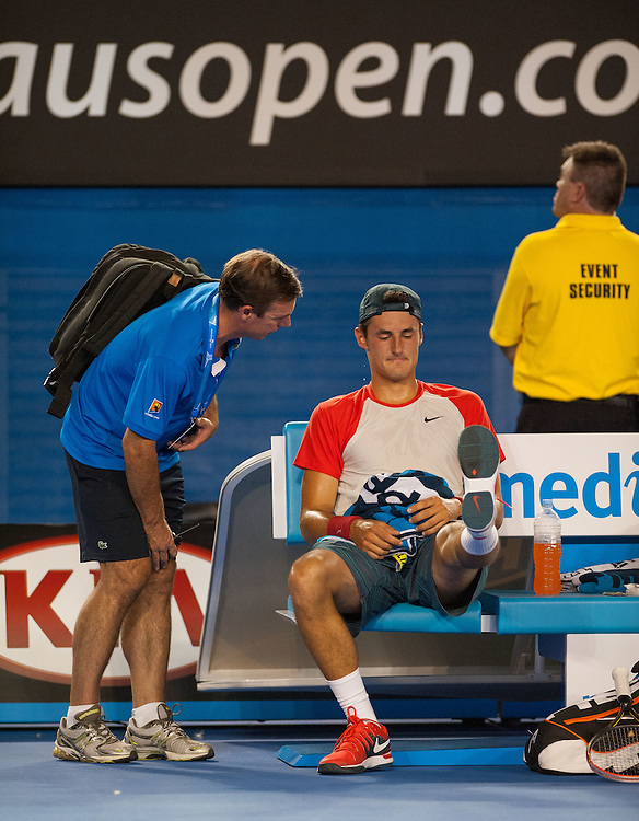 Bernard Tomic (AUS) faced R. Nadal (ESP) in day two play of the 2014 Australian Open at Melbourne's Rod Laver Arena. Tomic forfeited the match blaming leg pain giving Nadal the win. One set was completed during match play with Nadal up 6-4.