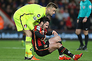 Bournemouth Goalkeeper Artur Boruc helps Adam Smith of Bournemouth before the Barclays Premier League match between Bournemouth and Manchester United at the Goldsands Stadium, Bournemouth, England on 12 December 2015. Photo by Phil Duncan.