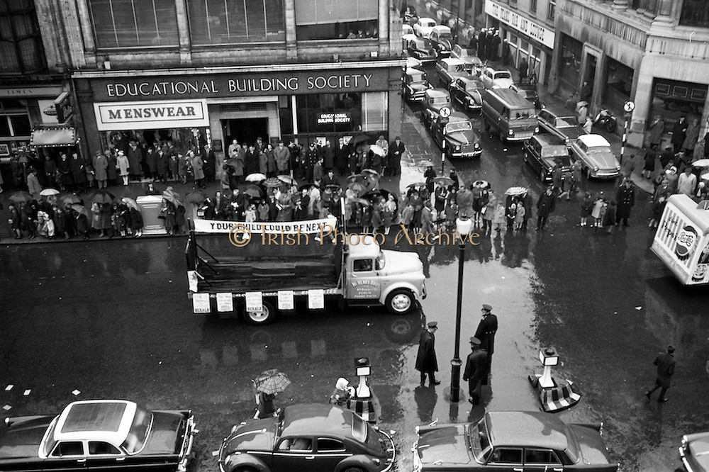 17/03/1963<br /> 03/17/1963<br /> 17 March 1963<br /> A rather ominous McHenry Brothers float in the N.A.I.D.A. St. Patricks Day Parade, warns of the danger of unfenced water hazards as it passes down  Westmoreland Street. Dublin.