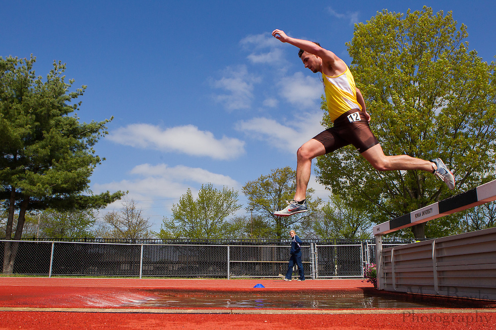 Rowan University sophomore Mike Davies competes in the men's 3000 meter steeplechase  at the NJAC Track and Field Championships at Richard Wacker Stadium on the campus of  Rowan University  in Glassboro, NJ on Sunday May 5, 2013. (photo / Mat Boyle)