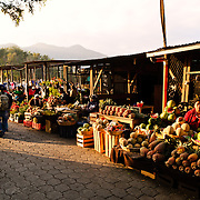 Fresh fruits and vegetables for sale at stalls at the main market in Antigua, Guatemala.
