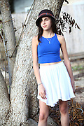 Young twelve year old preteen girl under a tree (model release available)