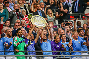 Manchester City lift the trophy after winning the FA Community Shield match between Manchester City and Liverpool at Wembley Stadium, London, England on 4 August 2019.