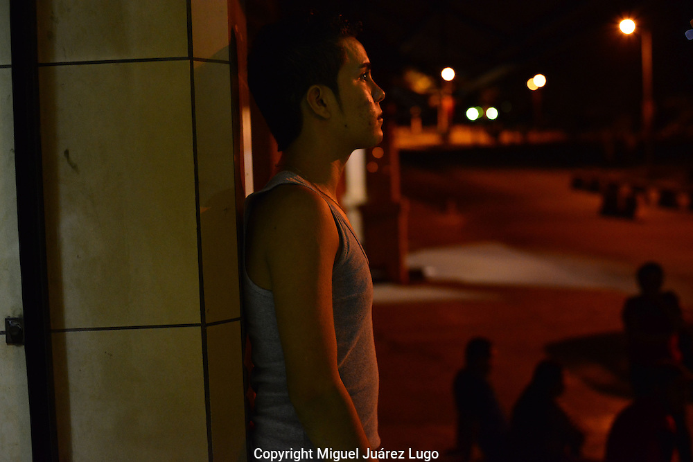Reynaldo Efrain Medina Jr., 16, waits for the bus. His father said he is a sweet, naïve boy who has no future if he stays in San Pedro Sula, where he lives in one of the poorest, most gang-infested neighborhoods of the city.