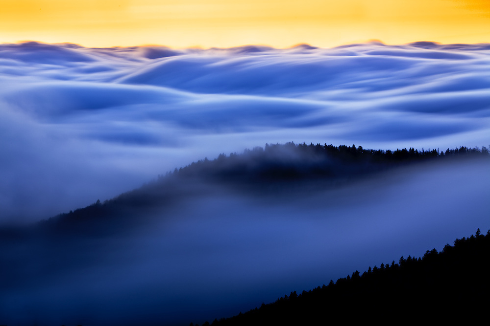 An ocean of clouds move through mountain ridges at twilight, Clingmans Dome, Great Smoky Mountains National Park, Tennessee and North Carolina
