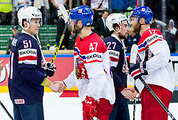 Jake Gardiner of USA, Michal Jordan of Czech Republic, Justin Faulk of USA and Jiri Novotny of Czech Republic after the Ice Hockey match between USA and Czech Republic at Third place game of 2015 IIHF World Championship, on May 17, 2015 in O2 Arena, Prague, Czech Republic. Photo by Vid Ponikvar / Sportida