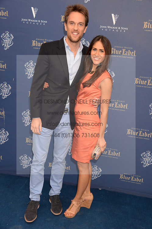 The Johnnie Walker Blue Label and David Gandy Drinks Reception aboard John Walker & Sons Voyager, St.Georges Stairs Tier, Butler's Wharf Pier, London, UK on 16th July 2013.<br /> Picture Shows:-Duncan Stirling and his wife Zoe.