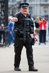 © Licensed to London News Pictures. 03/08/2016. London, UK. Armed police officers patrol during the change of guards on Horse Guards Parade in Westminster, London on 3 August 2016. More armed police will be seen on patrol in London, Metropolitan Police commissioner Sir Bernard Hogan-Howe and Mayor of London Sadiq Khan announced. Photo credit: Tolga Akmen/LNP