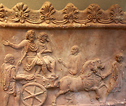 Terracotta panel showing part of a triumphal procession. Roman, made in Italy, 1st to early 2nd century. AD Two distressed captives are being paraded chained to a cart. They may be prisoners taken when Trajan defeated to Dacians in AD 107.
