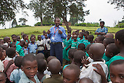 At Nyamiyaga primary school the Bwindi Community Hospital run health outreach programs. Reverend Sam, Head of Community Health, works on a nutrition game with the children. As part of the outreach programme they cover 32 primary schools and 5 secondary schools in the region as well as many communities. The main Bwindi Community Hospital is in Buhoma village on the edge of the Bwindi Impenetrable Forest in Western Uganda. It serves around 250,000 people from the surrounding area.