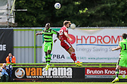 Drissa Traore and Andrew Shinnie jump for the ball during the Pre-Season Friendly match between Forest Green Rovers and Birmingham City at the New Lawn, Forest Green, United Kingdom on 16 July 2016. Photo by Shane Healey.