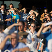Fans watch the racing as the sun sets during twilight horse racing at Canterbury race course, Sydney, Australia,  02 December 2009. Photo Tim Clayton.