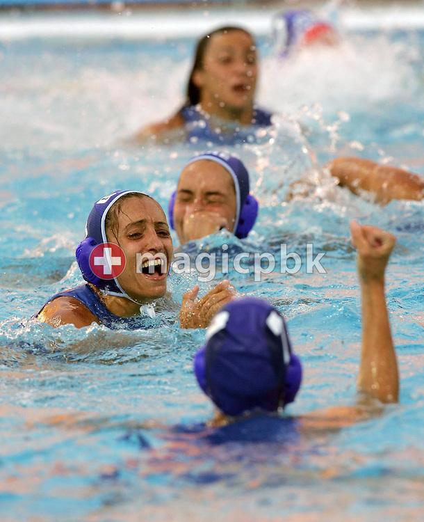 Greek player Angeliki Karapataki (C) cries as other teammates celebrate after their 6-2 semi-final win over Australia in Women's Water Polo at the Olympic Aquatic Centre in Athens Tuesday 24 August 2004.     (Photo by Patrick B. Kraemer / MAGICPBK)