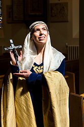 Pictured: Actress Katie Milne, dressed as St Margaret.<br /> <br /> Today Archbishop Leo Cushley was joined by 'St Margaret of Scotland' to unveil the publicity poster being sent to every Catholic parish in the country to advertise this summer's St Margaret's Pilgrimage, which will take place on 12 June in Dunfermline. Actress Katie Milne, dressed as St Margaret, joined the Archbishop in Edinburgh to launch the poster.<br /> <br /> Ger Harley | EEm 10 May April 2016