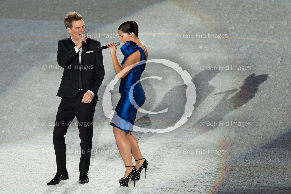 12 February 2010: Canadian Recording artists Nelly Furtado and Bryan Adams . The Opening Ceremony of the XXI Olympic Winter Games, the Vancouver 2010 Winter Olympics, held in BC Place Stadium  in Vancouver,  British Columbia, Canada..